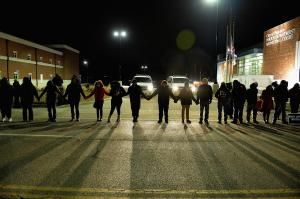 Protestors demonstrate in front of Ferguson Police Station