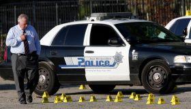 SAN BERNARDINO, CA. AUGUST 22, 2014 --- San Bernardino police investigators at the scene of an offic