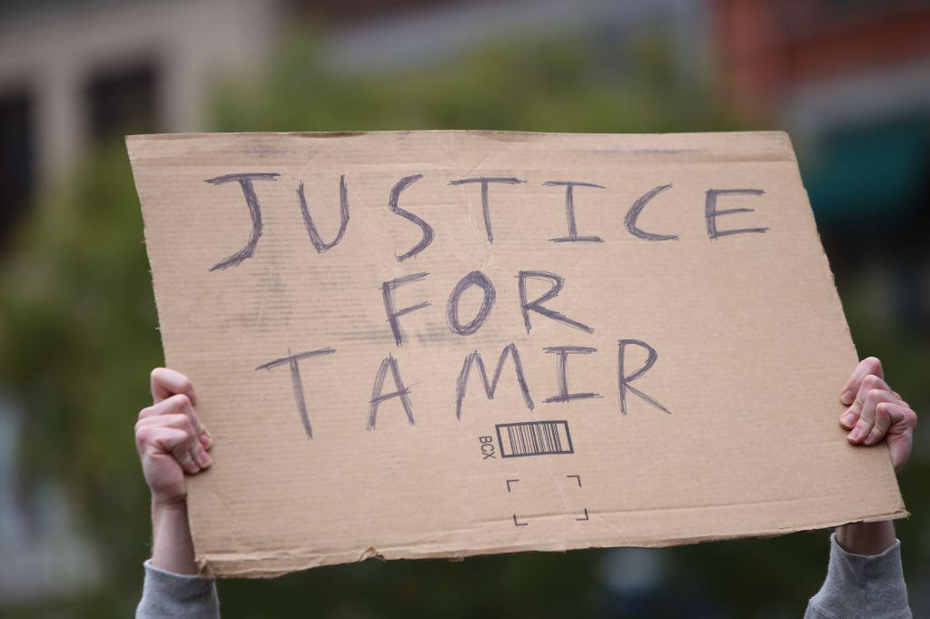 Justice for Tamir sign held aloft. Stop Mass Incarcerations...