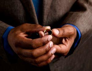 man holding ring