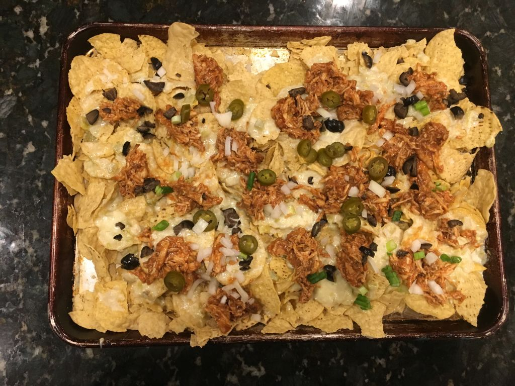 pulled chicken and queso nachos