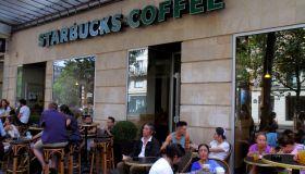 Paris, Boulevard de SŽbastopol Starbucks Coffee tables chairs customers alfresco
