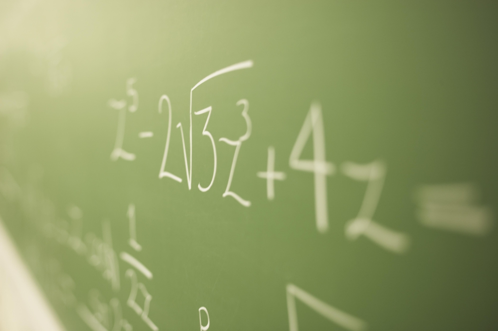 Math problems on chalkboard