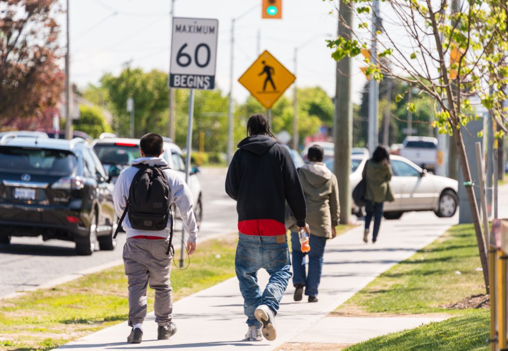 Youth walking on the street with low lowered pants. Sagging...