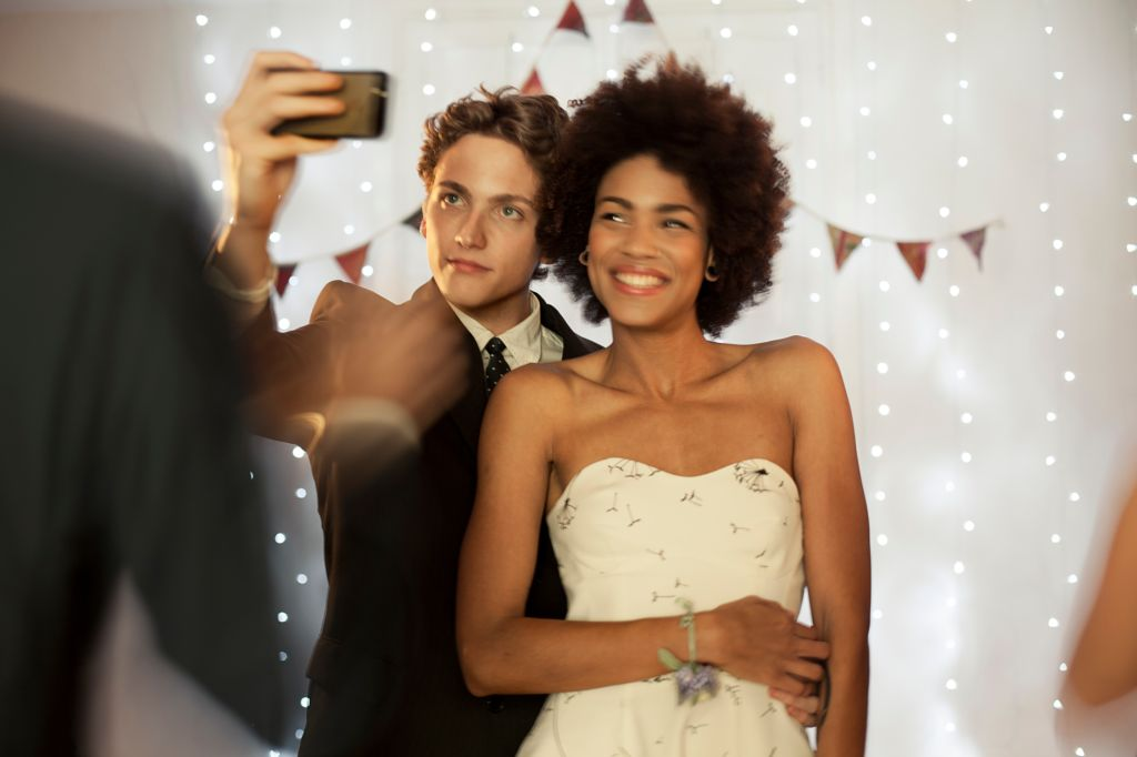 Couple taking a selfie at prom party