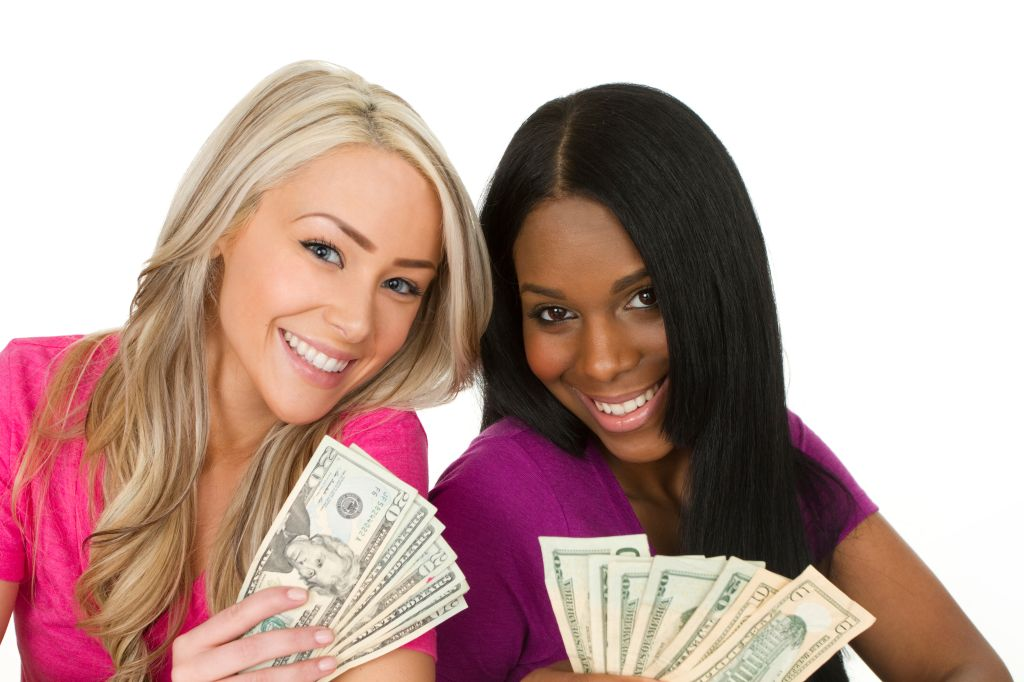 two young women with cash