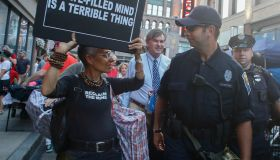 Activist with Stop Patriarchy with Cleveland police officer...