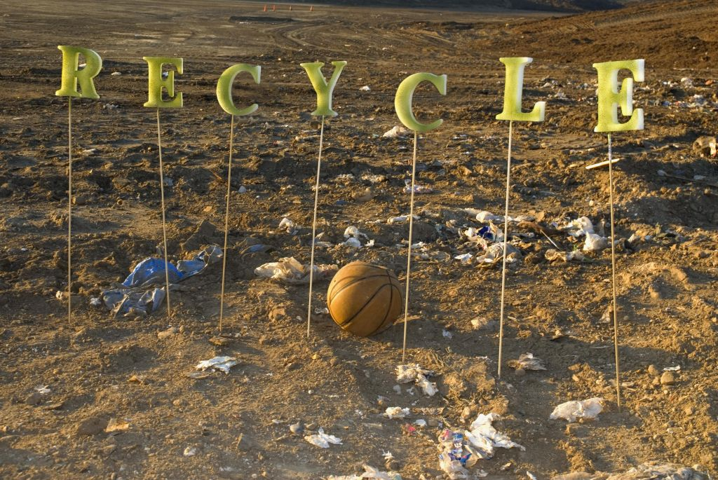The word 'Recycle' at a city dump.