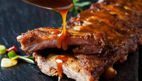Barbecue sauce dripping on marinated and grilled spare ribs