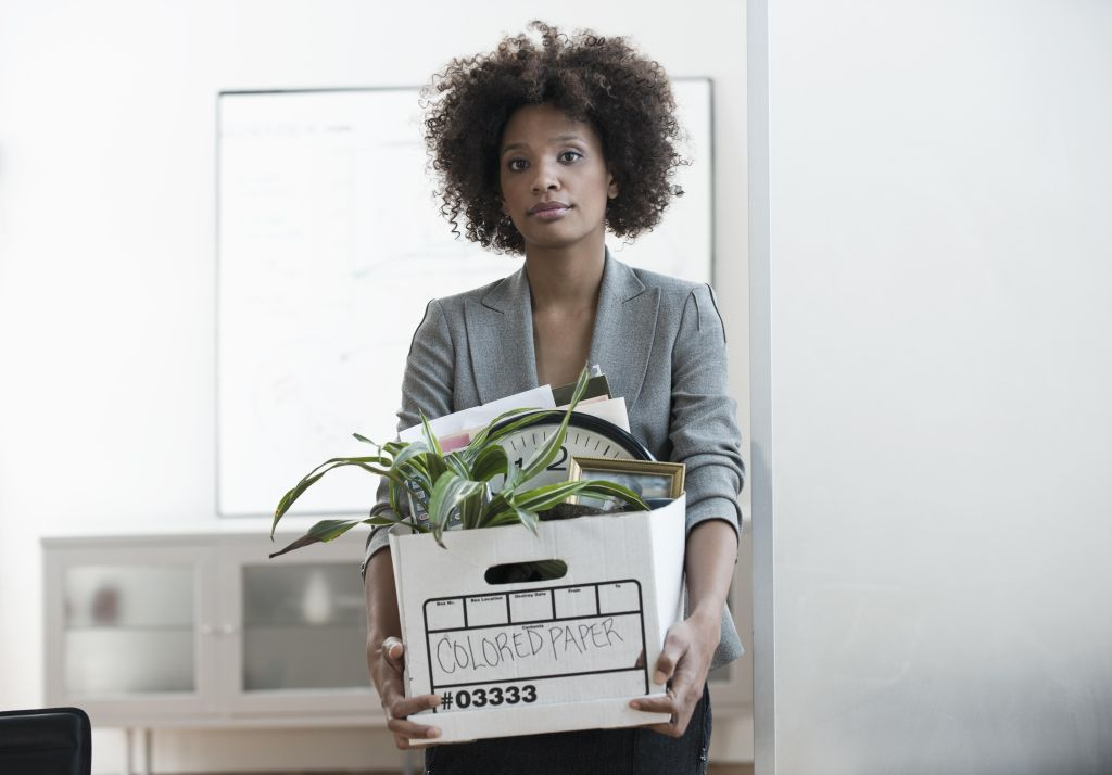Businesswoman packing up box in office