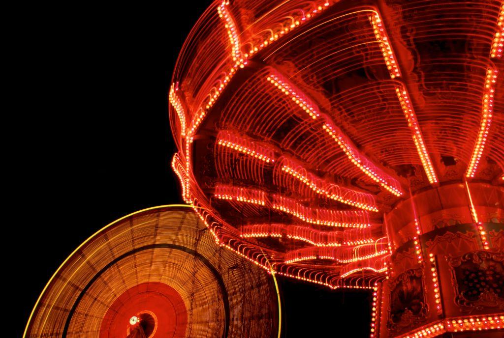 Spinning Amusement Park Rides at night.