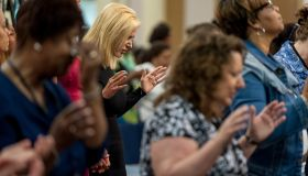 Visiting Pastor Paula White, a Pentecostal Christian televangelist, prays before giving a sermon to the congregation at Hope Christian Church...