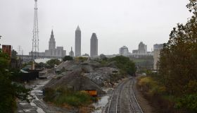 Industrial railway leading to the cloudy city skyline