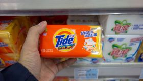 Tide and Arial laundry soaps on the shelves in a Chinese...