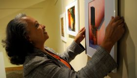 DENVER,CO--November 20Th 2009--Actress/photographer, Daphne Maxwell Reid, hangs one of her pictures at the Blair Caldwell African American Research Library Saturday evening. Reid was in town for her photographic exhibit entitled, 'Stepping Into the Future