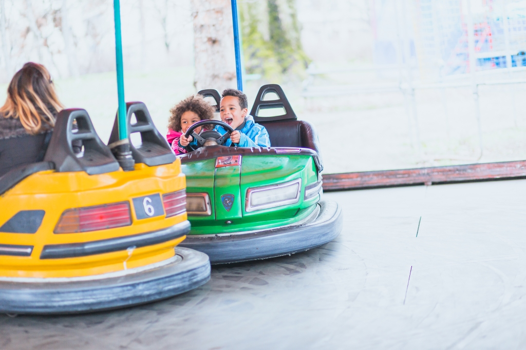 Single mother with children playing in amusement park