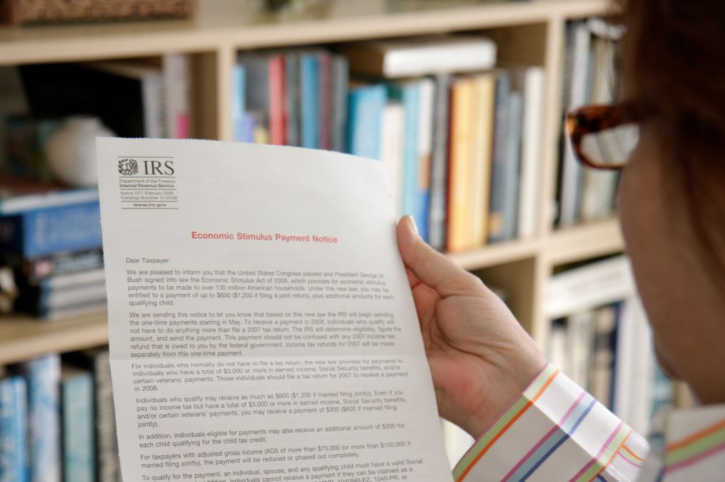 A woman reading a IRS document