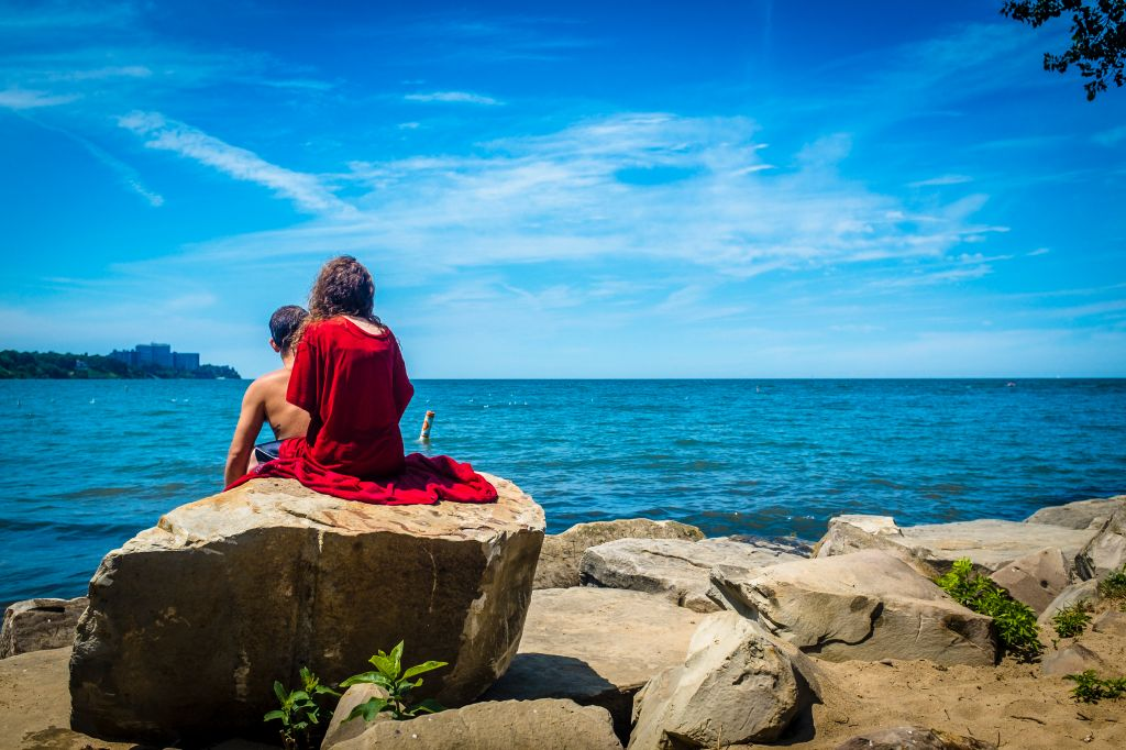 Couple sitting by the water