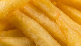 Fried french fry potatoes closeup for background