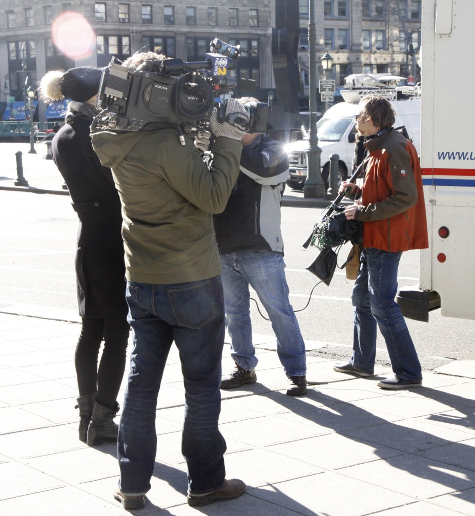 Members of the Press wait outside the New York State Supreme Court, with Madonna due to appear to fight her custody battle against former husband Guy Ritchie