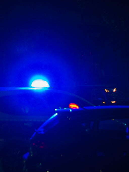 Blue Light Of Police Car In Street