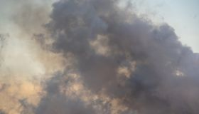 Smoke caused by explosions,Black smoke like clouds background.