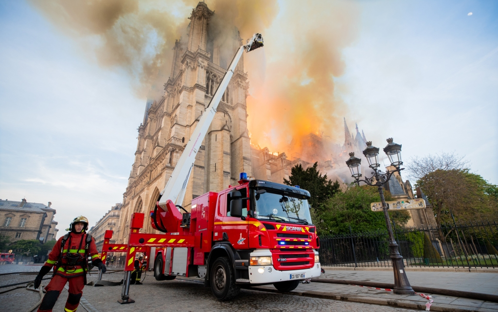 Firefighters tackle a major fire at the Notre Dame Cathedral in Paris