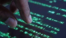 Hacker hand working on iPad