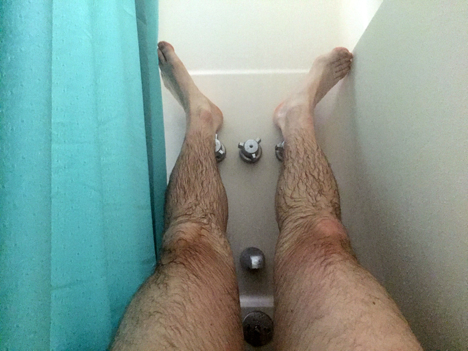 Feet resting in the shower