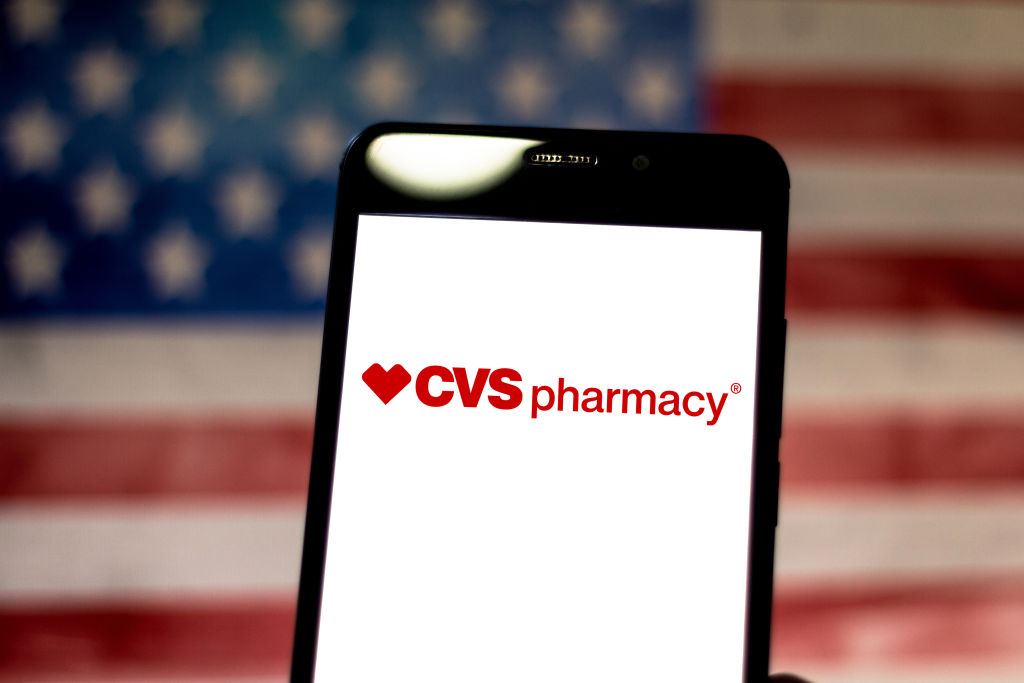 In this photo illustration the CVS Pharmacy logo is...