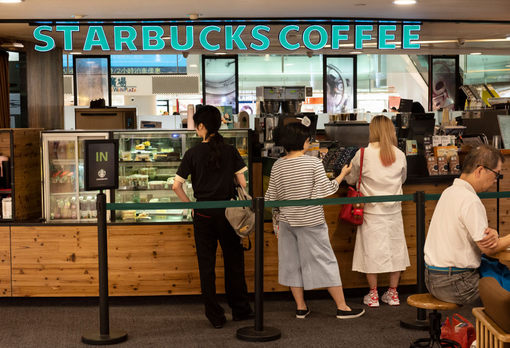 Customers seen purchasing Starbucks coffee at a shopping...