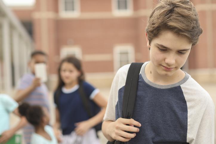 Junior high age boy being bullied at school.