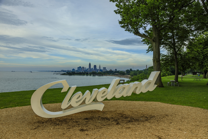 Cleveland script sign and city skyline at dusk - Edgewater Park