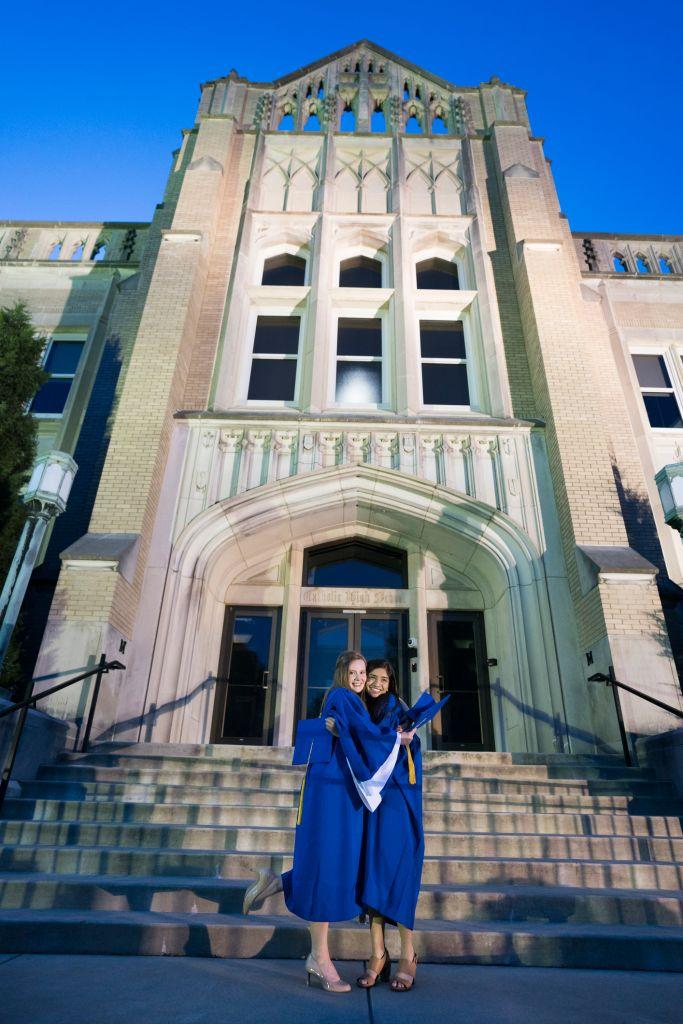 Graduating friends hugging