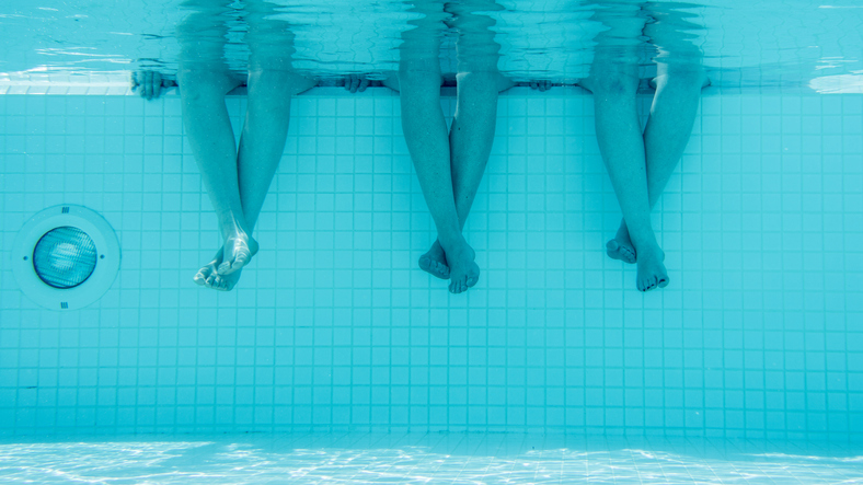 Low Section Of Women In Pool