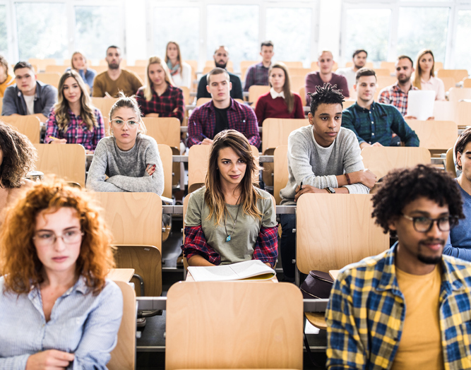 Large group of college students in a lecture hall.