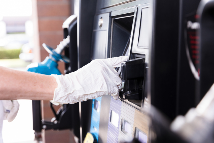 Woman uses contactless payment at gas pump