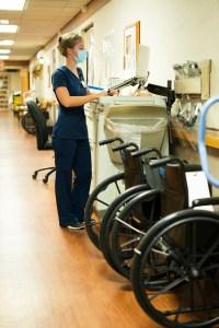 Nurse working in crowded hallway