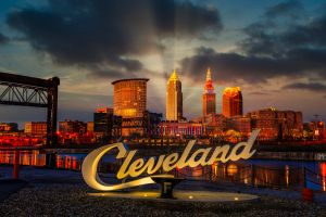 Cleveland script sign and city skyline at sunset - Flats West Bank