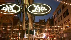 Lola Restaurant sign at night.