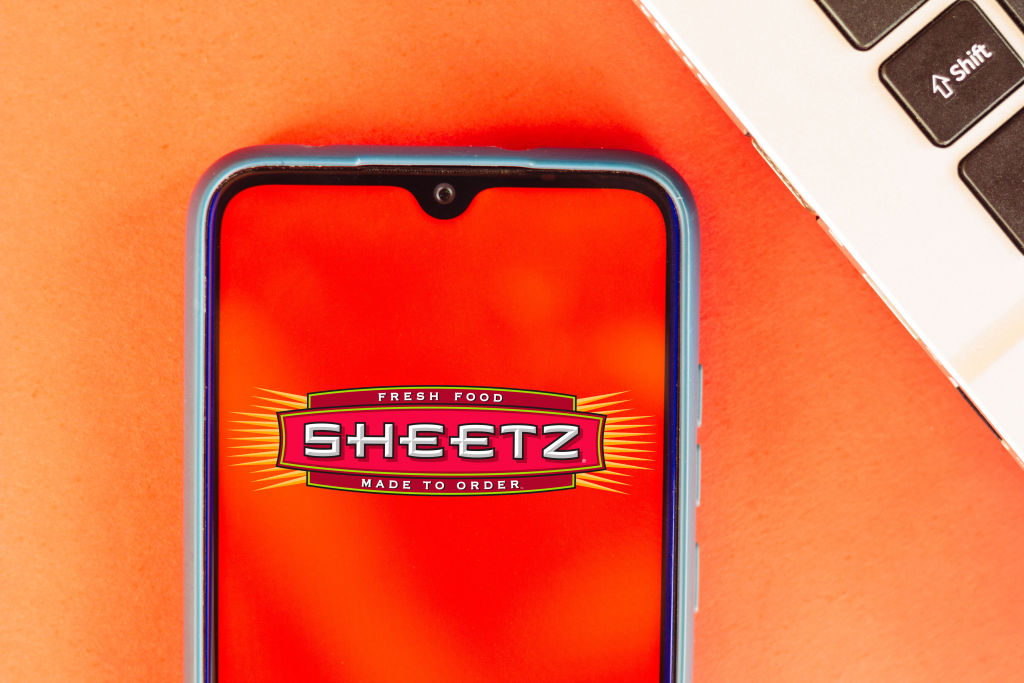 In this photo illustration the Sheetz logo seen displayed on...