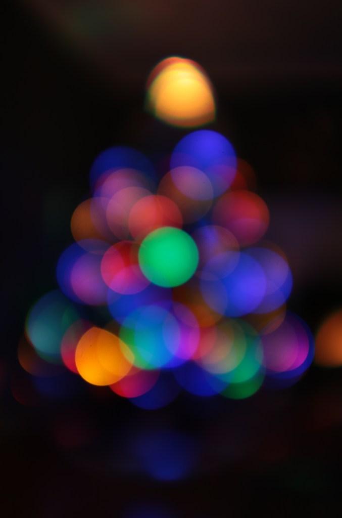 Defocused Christmas Tree with lighted orbs