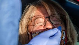 A woman receives a free Covid-19 test. Court Witschey the...