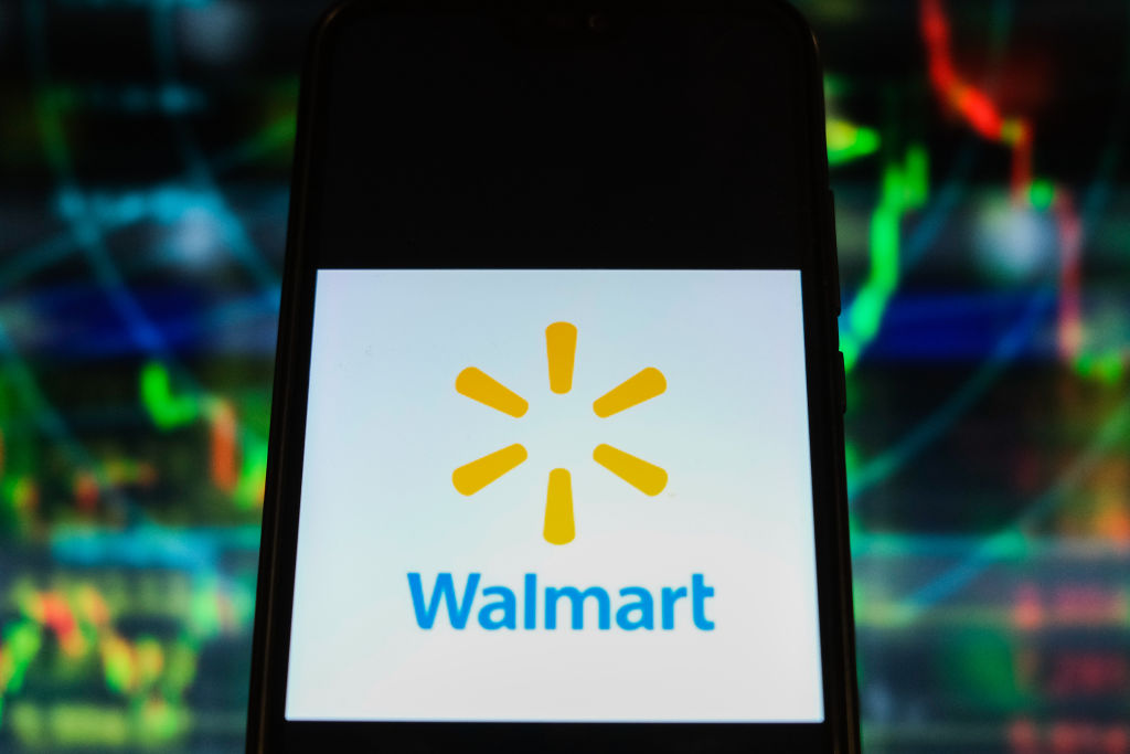 In this photo illustration a Walmart logo is displayed on a...