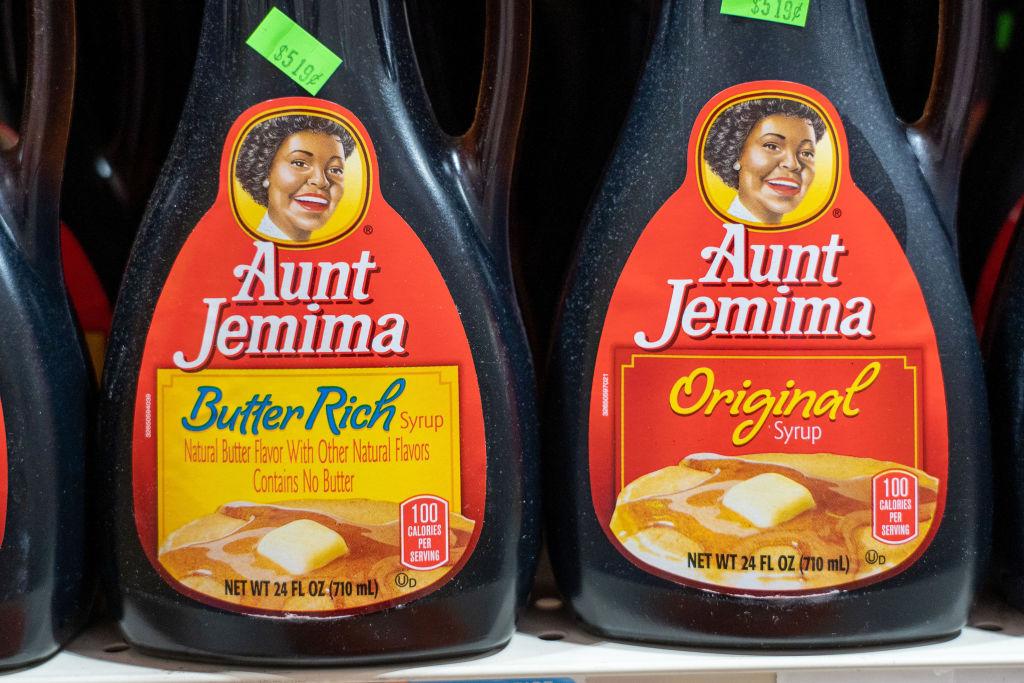 Aunt Jemima products seen displayed on supermarket shelves.