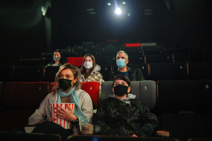 Audience watching the movie in cinema after the pandemic