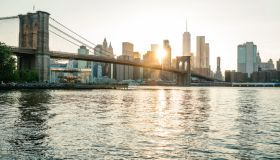 Brooklyn Bridge and Manhattan, New York during springtime during sunset