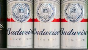 Cans of Budweiser beer seen at a supermarket...