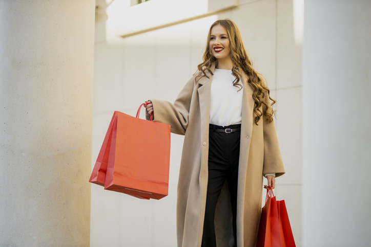 Beautiful female walking and shopping in city