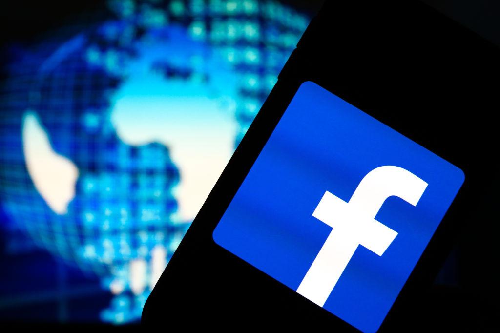 In this photo illustration a Facebook social media app logo...